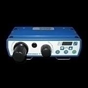 How do you control an external Fluid Dispenser on a spin coater?
